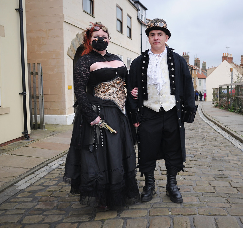 . WHITBY, ENGLAND - NOVEMBER 02: Vicky and Paul Allen from Preston dress as Steampunks as they visit the Goth weekend on November 2, 2013 in Whitby, England. The Whitby Gothic Weekend that takes place in the Yorkshire seaside town twice yearly in Spring and Autumn started in 1994 and sees thousands of extravagantly dressed followers of Victoriana, Steampunk, Cybergoth and Romanticism visit to take part in celebrating Gothic culture.  (Photo by Ian Forsyth/Getty Images)