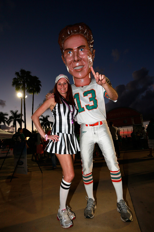 . MIAMI GARDENS, FL - OCTOBER 31: A fan in Halloween costume poses for photographs with a Dan Marino mascot prior to the game between the Miami Dolphins and the Cincinnati Bengals at Sun Life Stadium on October 31, 2013 in Miami Gardens, Florida. (Photo by Chris Trotman/Getty Images)