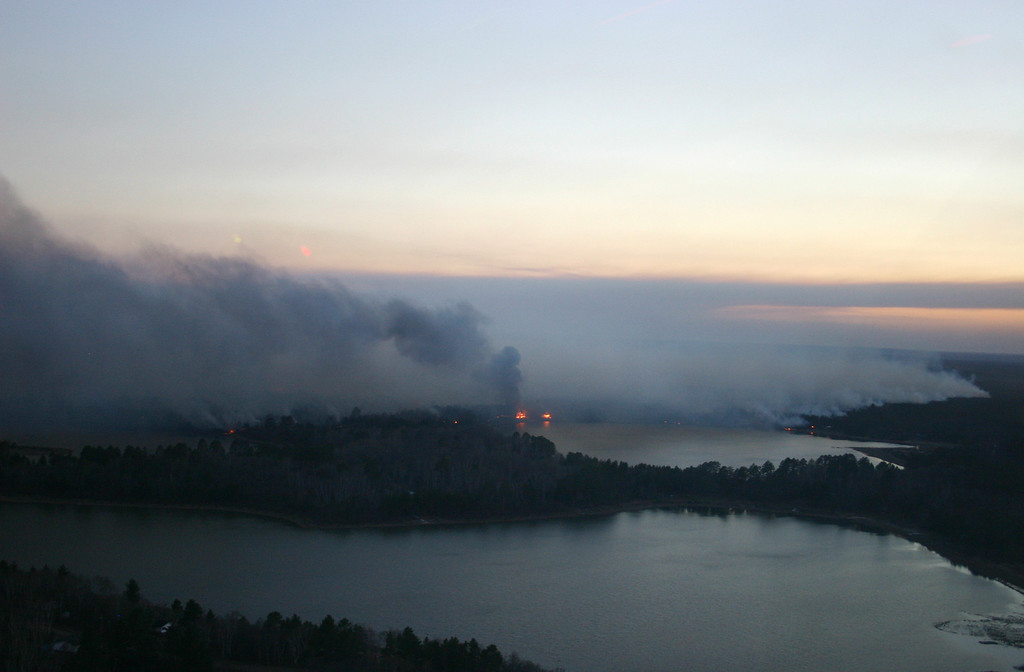 . This May 14, 2013, photo provided by the Wisconsoin Department of Natural Resources shows a smoky wildfire in northwestern Wisconsin that has consumed 8,700 acres, destroyed nearly 50 structures and forced dozens from their homes.  (AP Photo/Wisconsoin Department of Natural Resources)