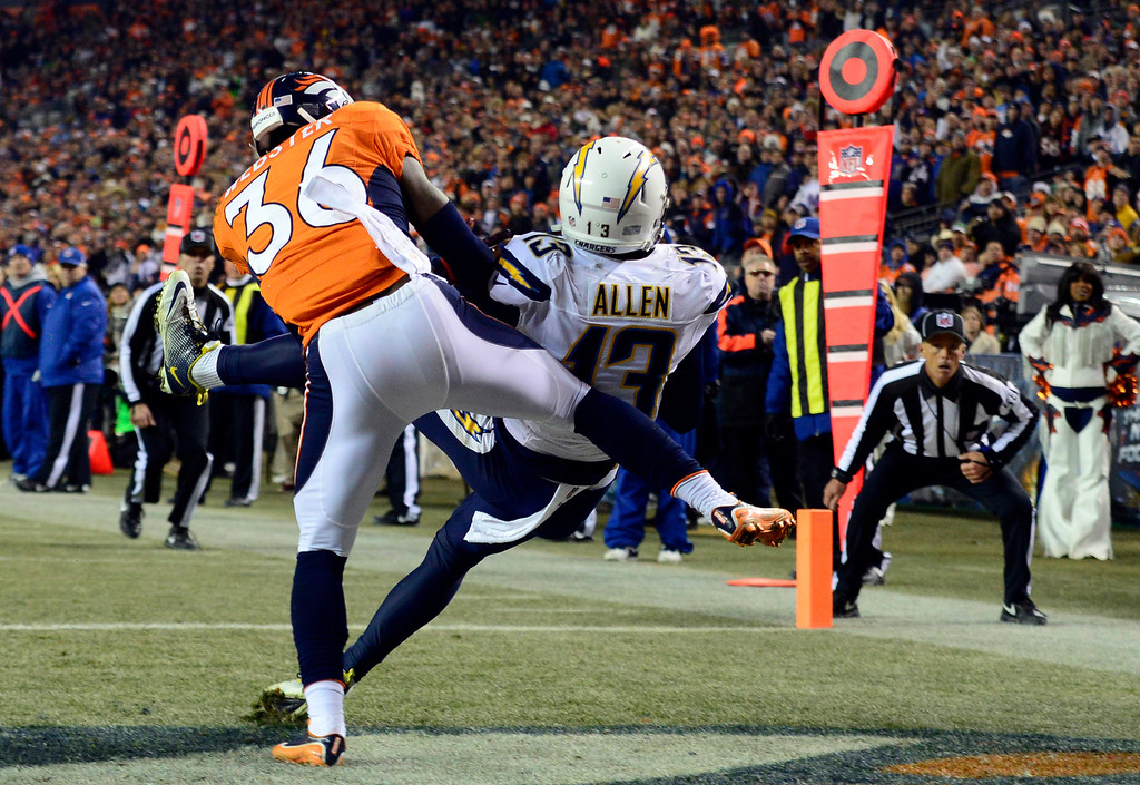. San Diego Chargers wide receiver Keenan Allen (13) scores a touchdown in the second quarter bringing the score to 17 Chargers 10 Broncos.  The Denver Broncos vs. the San Diego Chargers at Sports Authority Field at Mile High in Denver on December 12, 2013. (Photo by AAron Ontiveroz/The Denver Post)