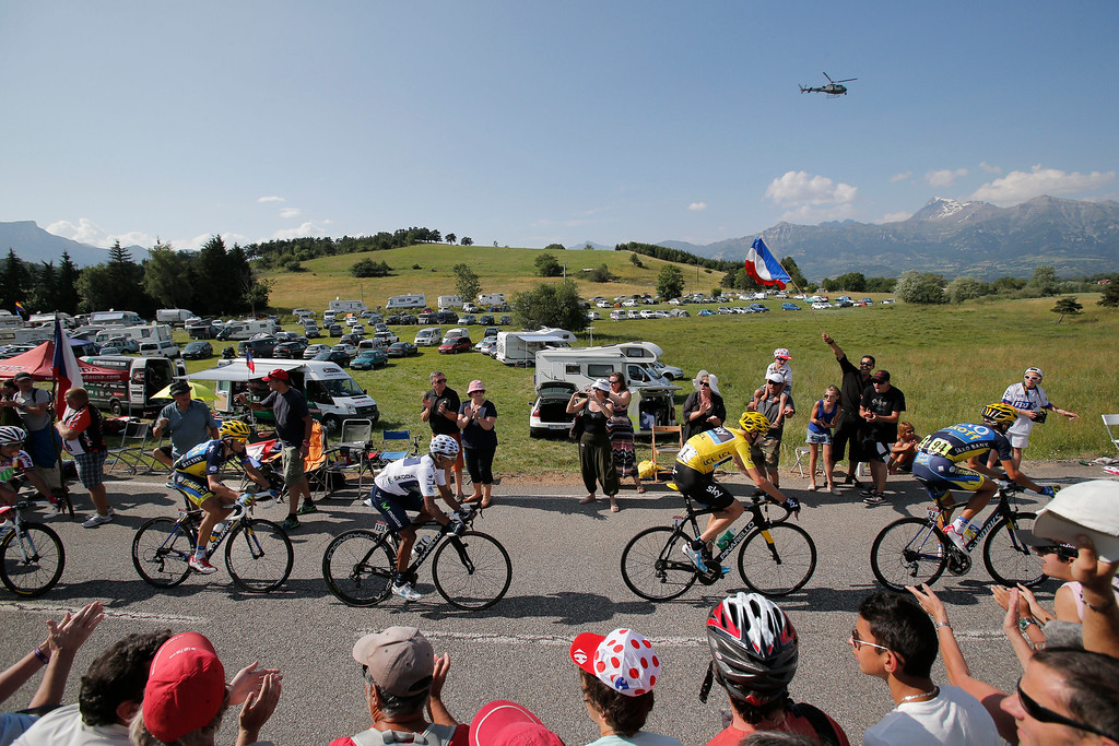 . Roman Kreuziger of the Czech Republic, right, , wearing the overall leader\'s yellow jersey, Nairo Alexander Quintana of Colombia, wearing the best young rider\'s white jersey, and Spain\'s Alberto Contador, second left, climb Manse pass during the sixteenth stage of the Tour de France cycling race over 168 kilometers (105 miles) with start in in Vaison-la-Romaine and finish in Gap, France, Tuesday July 16, 2013. (AP Photo/Christophe Ena)