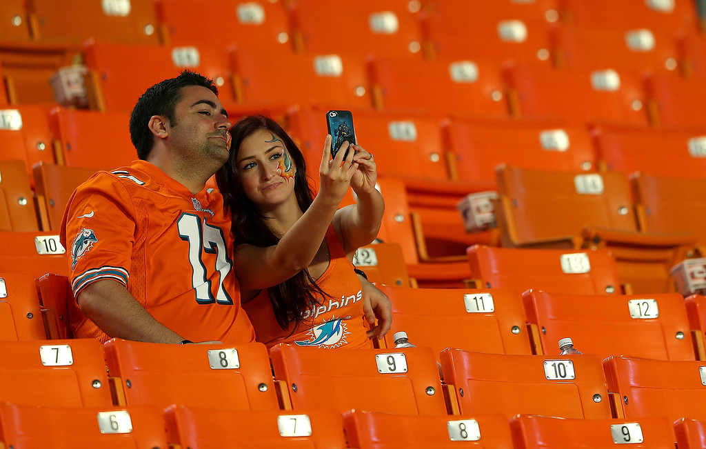 . MIAMI GARDENS, FL - OCTOBER 31:  Miami Dolphins fans wait for the start of a game against the Cincinnati Bengals at Sun Life Stadium on October 31, 2013 in Miami Gardens, Florida.  (Photo by Mike Ehrmann/Getty Images)