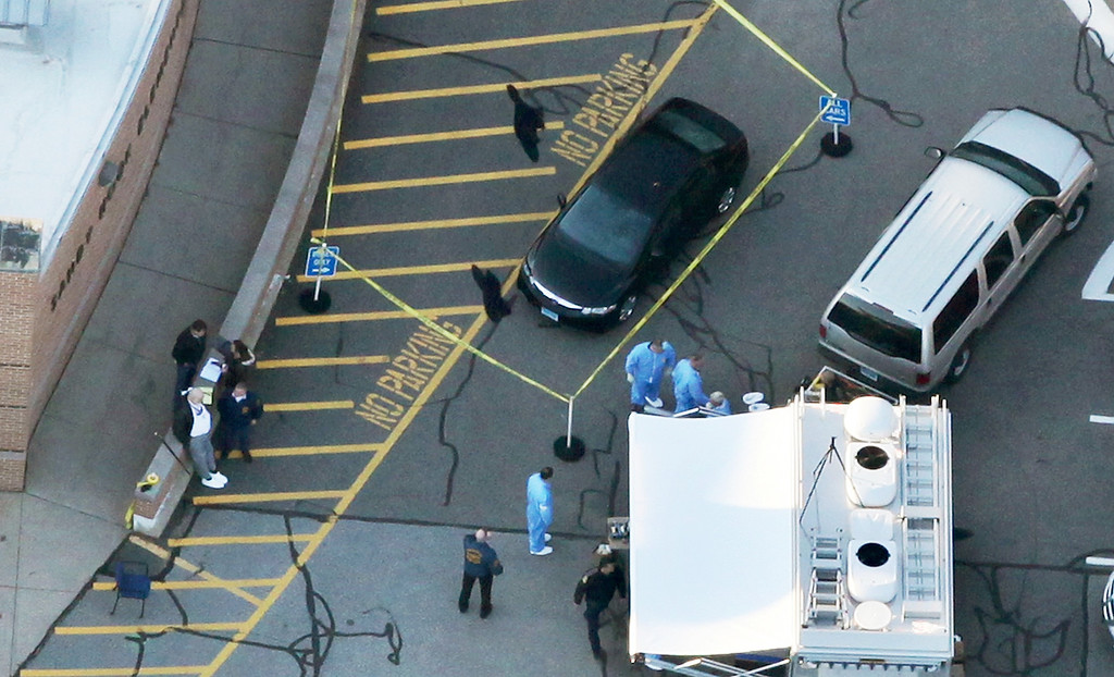 . Responders gather at the scene of a mass shooting at Sandy Hook Elementary School with police tape surrounding a vehicle on December 14, 2012 in Newtown, Connecticut. Twenty-seven are dead, including 20 children, after a gunman identified as Adam Lanza in news reports, opened fire in the school. Lanza also reportedly died at the scene.  (Photo by Mario Tama/Getty Images)
