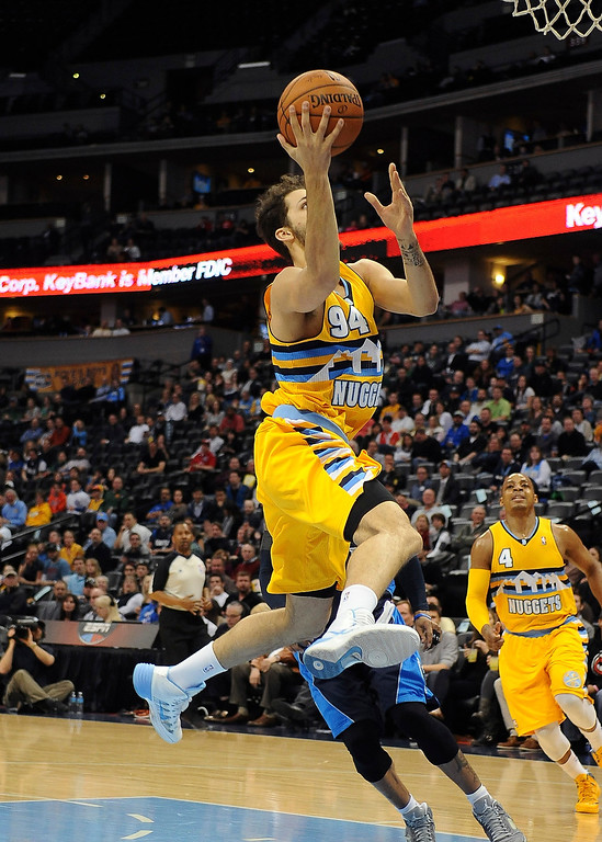 . Denver Nuggets guard Evan Fournier drives for a layup in the first quarter against of the Dallas Mavericks Wednesday night at the Pepsi Center. (Photo By Steve Nehf / The Denver Post)