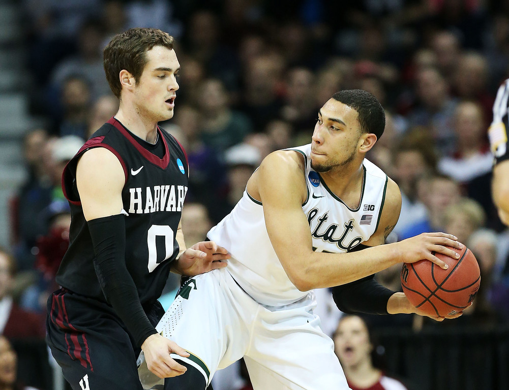 . SPOKANE, WA - MARCH 22:  Laurent Rivard #0 of the Harvard Crimson defends against Denzel Valentine #45 of the Michigan State Spartans in the second half during the Third Round of the 2014 NCAA Basketball Tournament at Spokane Veterans Memorial Arena on March 22, 2014 in Spokane, Washington.  (Photo by Stephen Dunn/Getty Images)