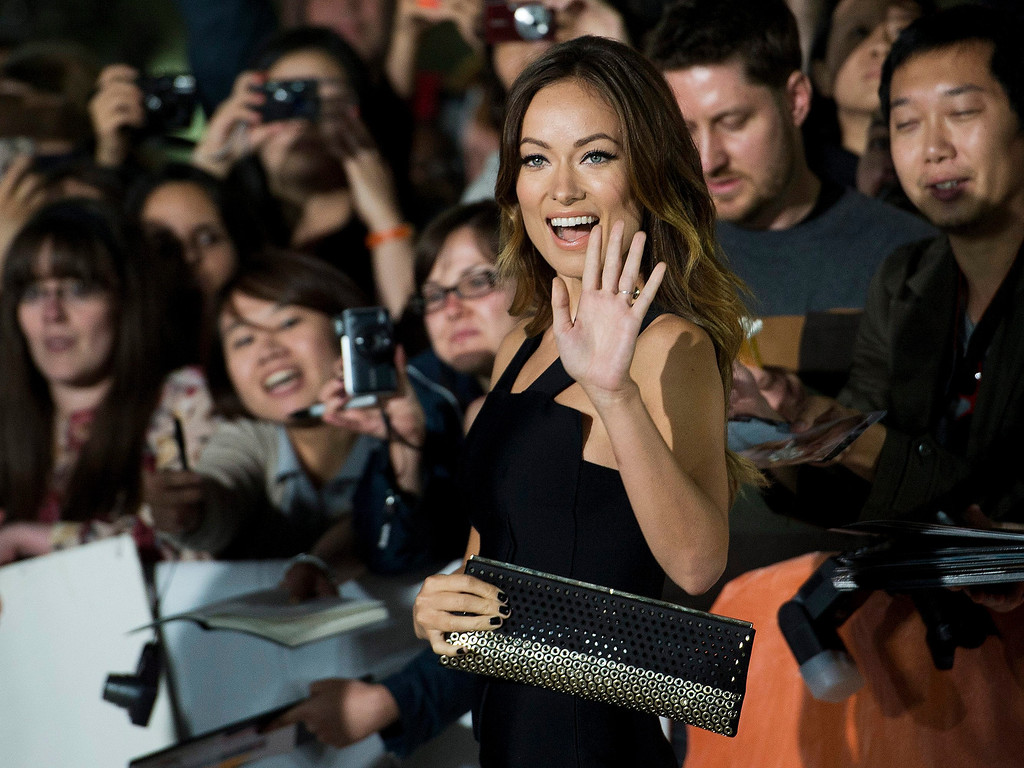 ". Actress Olivia Wilde poses for a photograph on the red carpet at the gala for the new movie ""Rush\"" during the 2013 Toronto International Film Festival in Toronto on Sunday, Sept. 8, 2013. (AP Photo/The Canadian Press, Nathan Denette)"