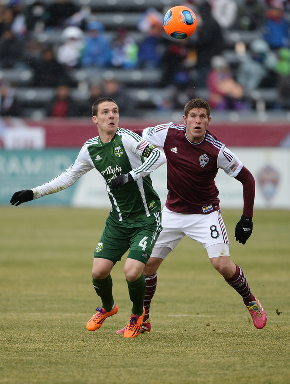 . COMMERCE CITY MARCH 22: Dillon Powers of Colorado Rapids (8) and Will Johnson of Portland Timbers (4) are chasing the ball in the 1st half of the game at Dick\'s Sporting Goods Park. Commerce City, Colorado. March 22. 2014. Colorado won 2-0. (Photo by Hyoung Chang/The Denver Post)