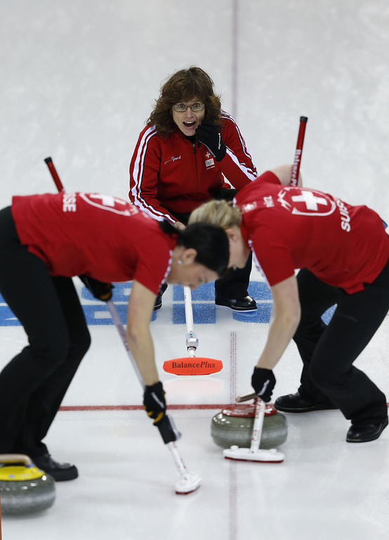 . Switzerland\'s Mirjam Ott (top) watches her last stone during the women\'s curling round robin session 5 match between Switzerland and Sweden at the Ice Cube curling centre in Sochi on February 13, 2014 during the 2014 Sochi winter Olympics. ADRIAN DENNIS/AFP/Getty Images