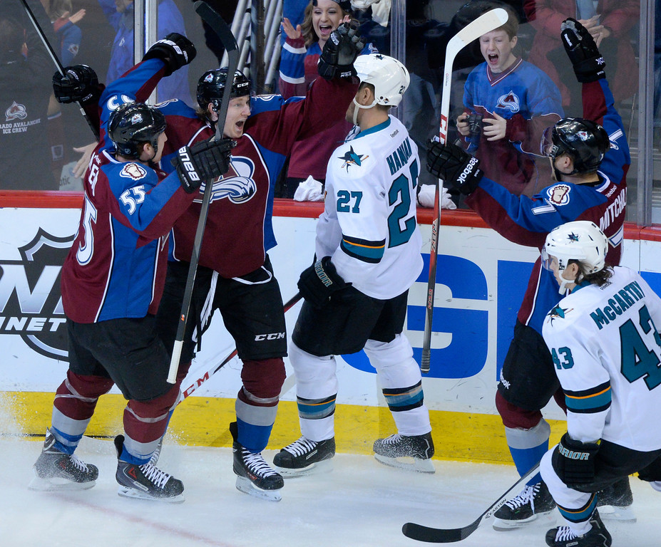 . DENVER, CO. - JANUARY 04:  Colorado center Nathan MacKinnon (29) celebrated a goal with teammates Cody McLeod and John Mitchell in the second period. The Colorado Avalanche hosted the San Jose Sharks at the Pepsi Center Saturday afternoon, January 4, 2014. Photo By Karl Gehring/The Denver Post