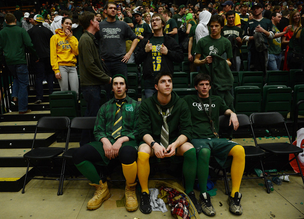. Fort COLLINS, CO. - FEBRUARY 23: CSU students Ben Saccomano and his brother San and Chris Albright remain in their seats following the their teams loss to New Mexico at Moby Arena in Fort Collin, CO February  24, 2013. The Colorado State Rams mens basketball team lost to the New Mexico Lobos, 82-91. (Photo By Craig F. Walker/The Denver Post)