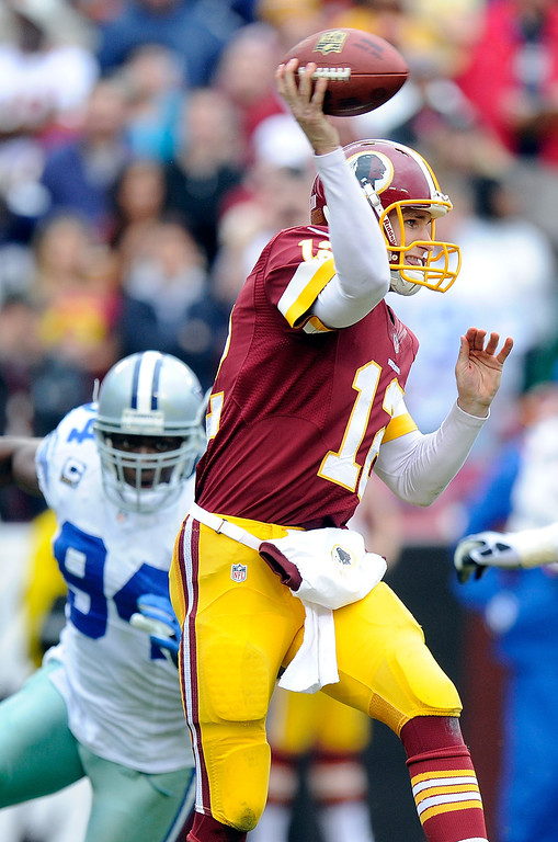 . Kirk Cousins #12 of the Washington Redskins throws a pass in the second quarter against the Dallas Cowboys at FedExField on December 22, 2013 in Landover, Maryland.  (Photo by Greg Fiume/Getty Images)
