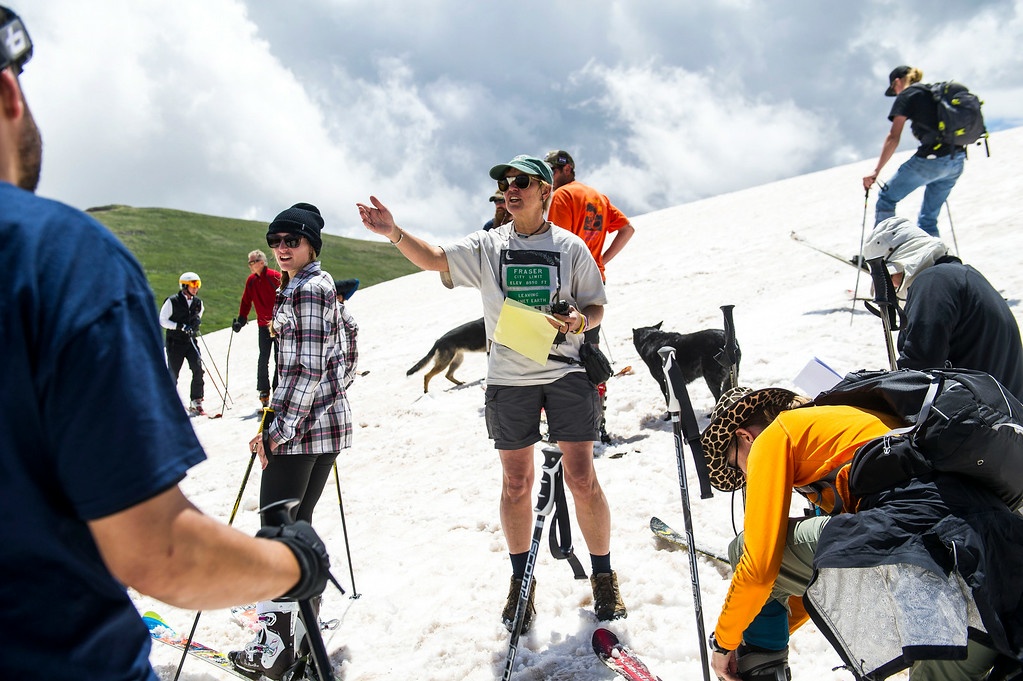 . Toni Leuthold, of Winter Park gives instructions before the start of the 49th running of the Epworth Cup, an unofficial ski race atop Corona Pass on Sunday, July 13, 2014 in Winter Park, CO.  The summer ski race, which was originally founded in 1966 is a memorial to a Winter Park patroller that died on Mt. Epworth.  (Photo by Kent Nishimura/The Denver Post)