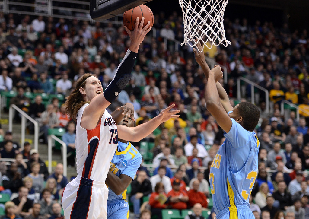 . SALT LAKE CITY, UT - MARCH 21:  Kelly Olynyk #13 of the Gonzaga Bulldogs shoots over Malcolm Miller #33 of the Southern University Jaguars in the first half during the second round of the 2013 NCAA Men\'s Basketball Tournament at EnergySolutions Arena on March 21, 2013 in Salt Lake City, Utah.  (Photo by Harry How/Getty Images)