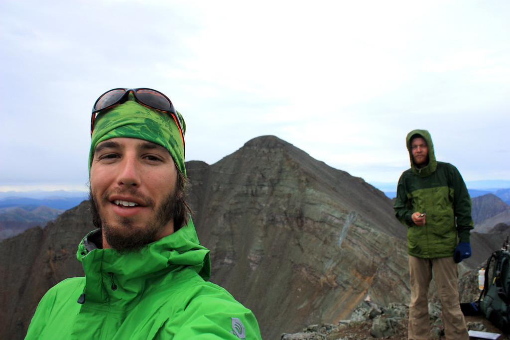. Luke DeMuth, left, and Junaid Dawud stand atop Conundrum Peak in August, the 25th peak of the pair\'s mission to climb 58 of the state\'s 14,000-foot peaks in a single hike. The pair have hiked 1,300 miles and climbed 57 of the state\'s 58 14,000-foot peaks and plan to finish their 70-day mission Sunday on Longs Peak.