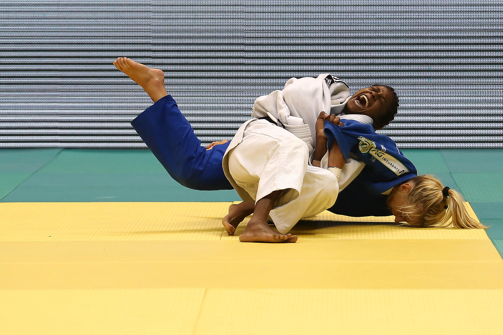 . RIO DE JANEIRO, BRAZIL - AUGUST 26: Maria Celia  Laborde of Cuba (white) fights against Charline Van Snick of Belgium in the -48 kg category during the World Judo Championships at the Maracanazinho gymnasium on August 26, 2013 in Rio de Janeiro, Brazil. (Photo by Buda Mendes/Getty Images)