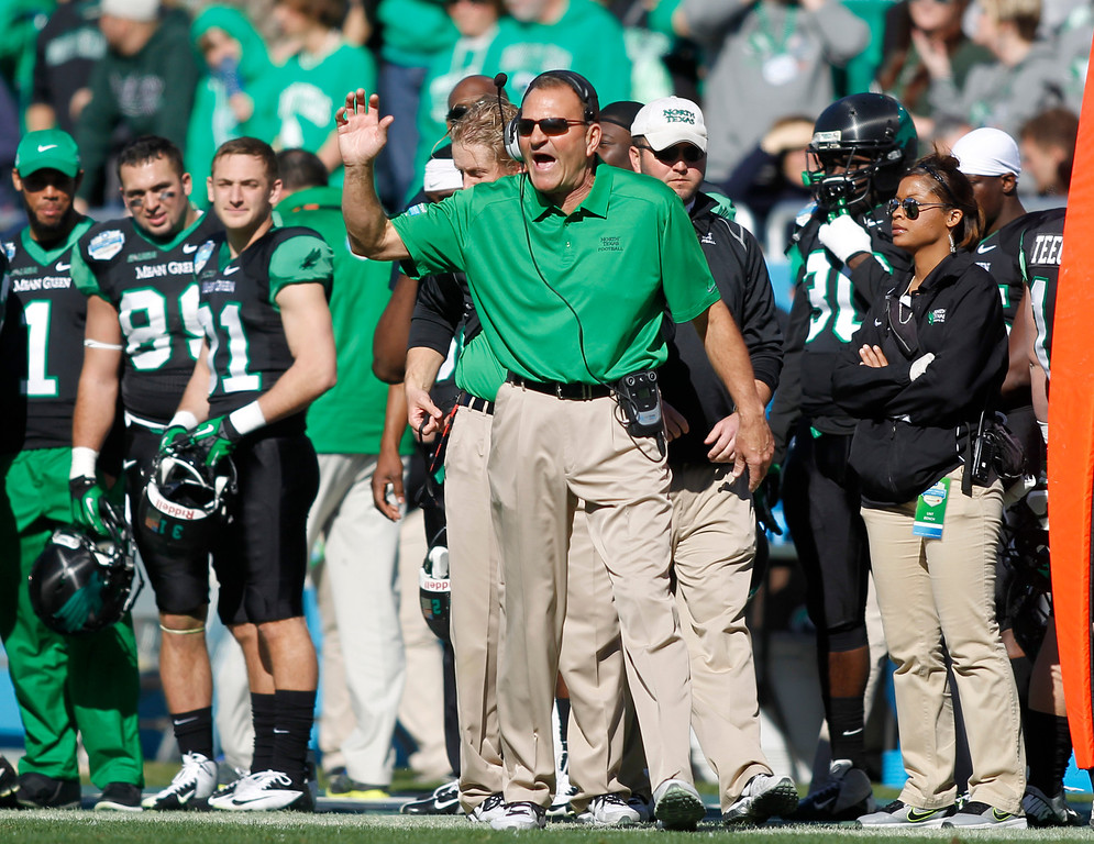 . North Texas head coach Dan McCarney gestures towards the field against UNLV during the first half of the Heart of Dallas NCAA college football game, Wednesday, Jan. 1, 2014, in Dallas. (AP Photo/Mike Stone)