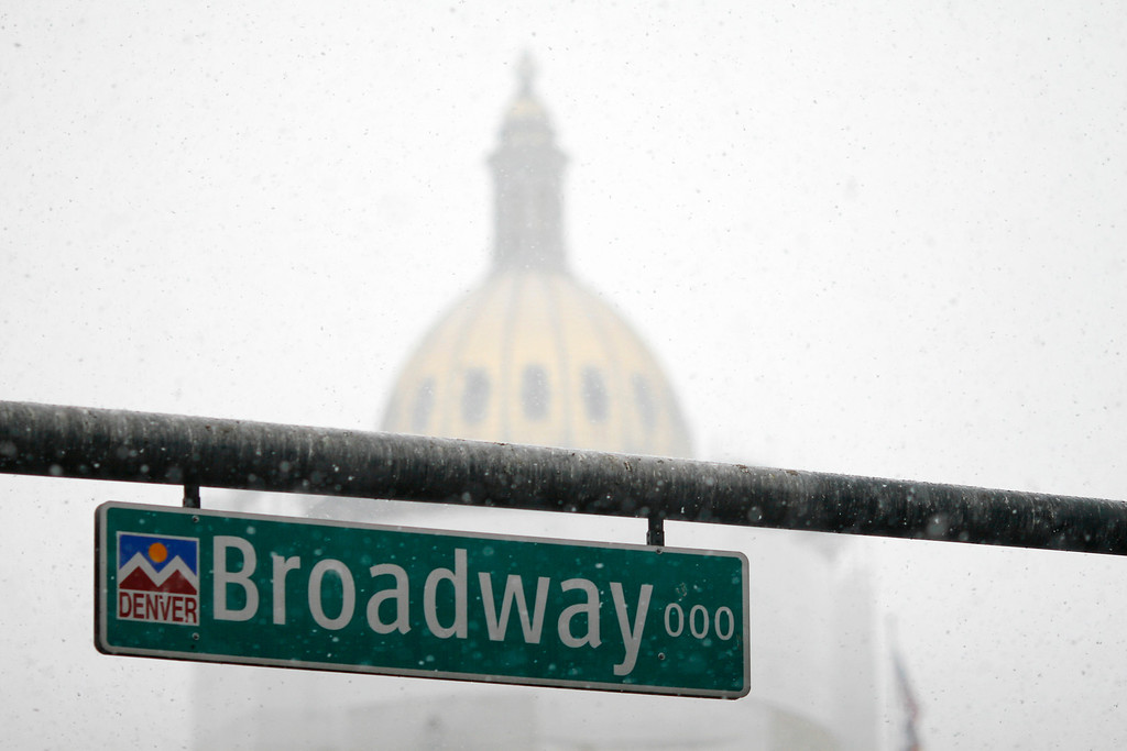 . Snow falling in Denver nearly obscures the Colorado State Capitol just a block away from Broadway at about 8 a.m., Saturday, March 9, 2013. Daniel J. Schneider, The Denver Post