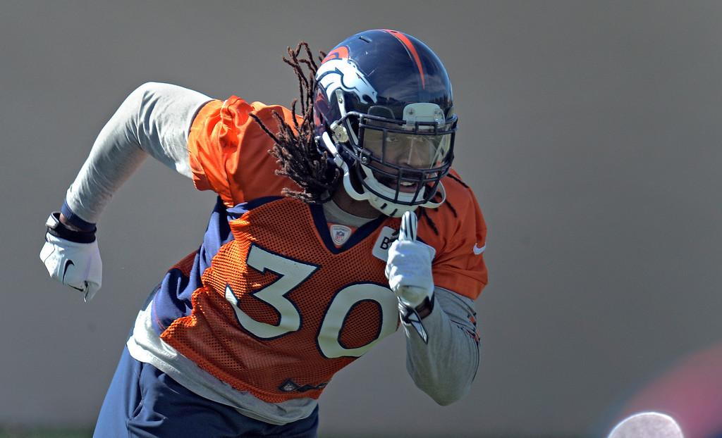 . Denver Broncos strong safety David Bruton (30) runs through drills during practice October 16, 2013 at Dove Valley. (Photo by John Leyba/The Denver Post)