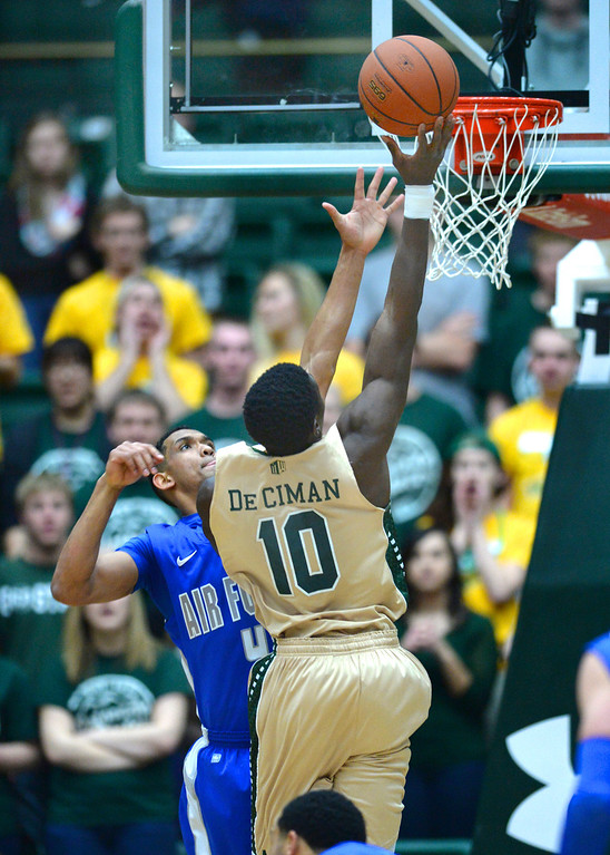 . FORT COLLINS, CO. - JANUARY 18:  Colorado State sophomore guard Joe DeCiman (10) went to the hoop against Air Force defender Kamryn Williams (4) in the first half. The Colorado State men\'s basketball team hosted Air Force at Moby Arena in Fort Collins Saturday night, January 18, 2014. Photo By Karl Gehring/The Denver Post