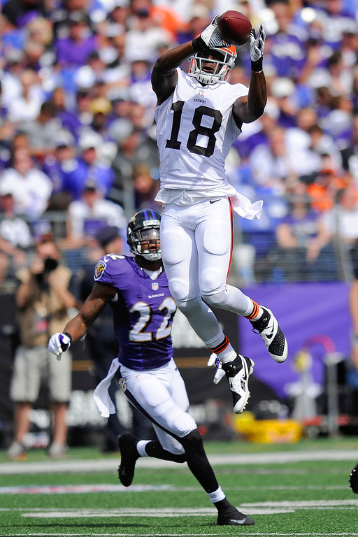 . Cleveland Browns wide receiver Greg Little (18) pulls in a pass as Baltimore Ravens cornerback Jimmy Smith (22) closes in during the first half of an NFL football game in Baltimore, Md., Sunday, Sept. 15, 2013. (AP Photo/Nick Wass)