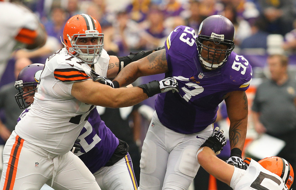 . John Greco #77 of the Cleveland Browns puts the pressure on Kevin Williams #93 of the Minnesota Vikings on September 22, 2013 at Mall of America Field at the Hubert Humphrey Metrodome in Minneapolis, Minnesota. (Photo by Adam Bettcher/Getty Images)