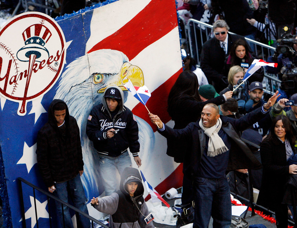 . New York Yankees baseball player  Mariano Rivera, right, waves during a ticker-tape parade along Broadway celebrating their 27th World Series championship on Friday, Nov. 6, 2009,  in New York.   (AP Photo/Jason DeCrow)