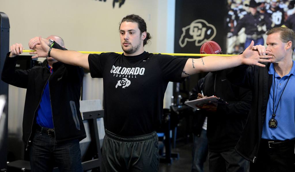 . Jon Major gets measured by NFL scouts on Wednesday. Scouts from around the NFL  tested and watched University of Colorado football players during CU pro timing day on Wednesday. (Cliff Grassmick/Boulder Daily Camera)