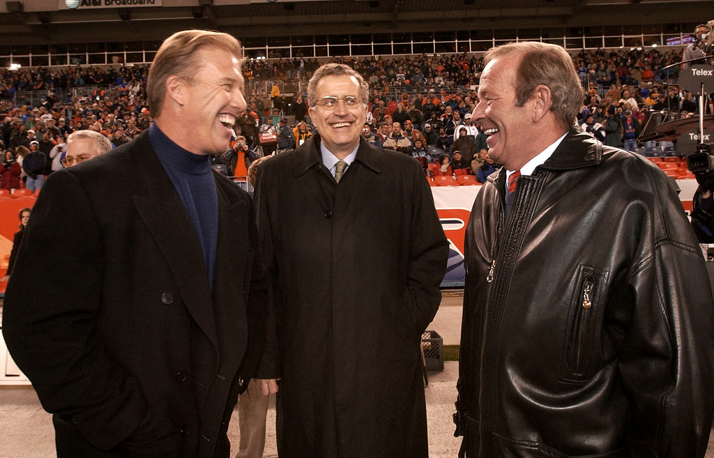 . Former Denver Broncos QB John Elway shares a laugh with Owner Pat Bowlen and NFL Commissioner Paul Tagliabue in pregame activities during Monday Night Football at Invesco at Mile High Stadium in 2002.  Photo by John Leyba, The Denver Post