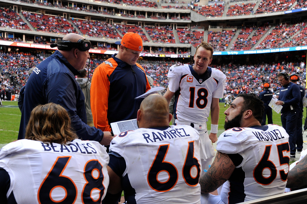 """. Quarterback Peyton Manning #18 of the Denver Broncos talks to the \""""O\"""" line in the 4th quarter against the Houston Texans at Reliant Stadium December 22, 2013 Houston, Texas. (Photo By Joe Amon/The Denver Post)"""