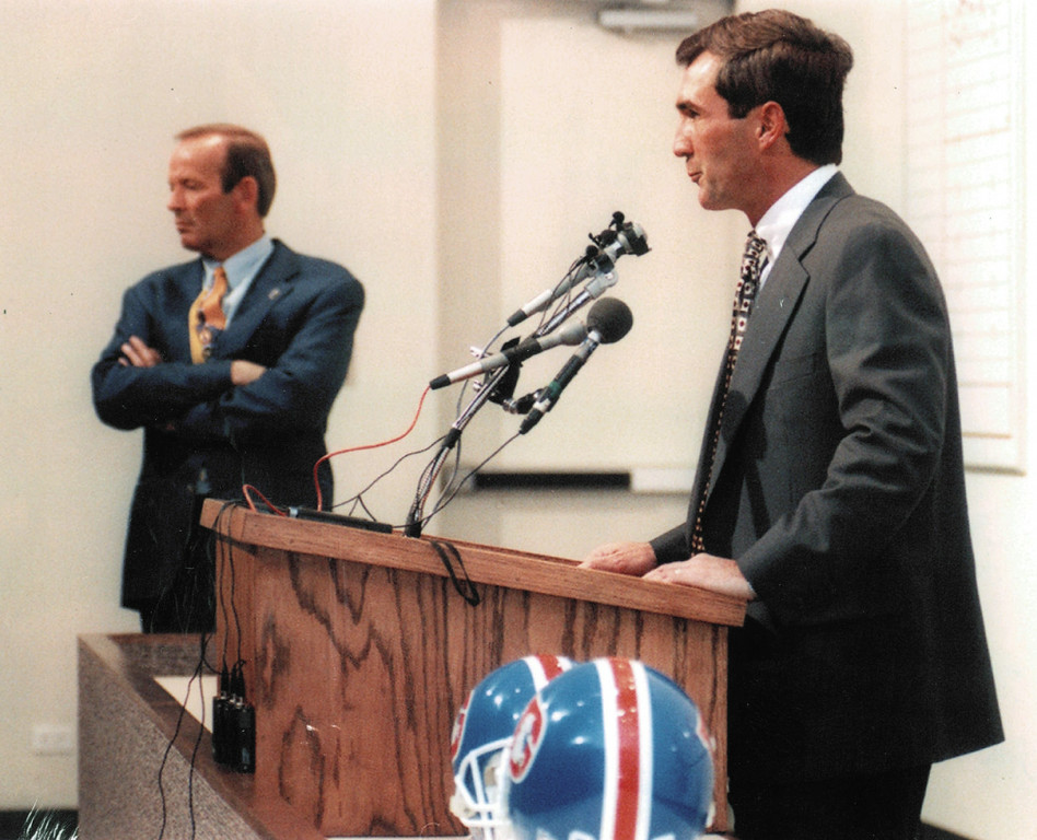 . Pat Bowlen presents the new coach Mike Shanahan in 1995. Denver Post Library photo archive