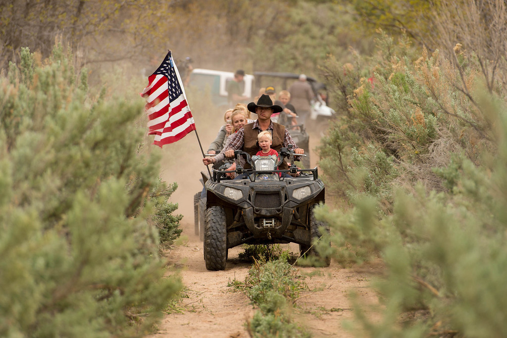 . Ryan Bundy, son of the Nevada Rancher Cliven Bundy, rides an ATV through Recapture Canyon, which has been closed to motorized use since 2007, after a call to action by San Juan County Commissioner Phil Lyman. Saturday May 10, 2014 north of Blanding. (Photo by Trent Nelson/The Salt Lake Tribune)