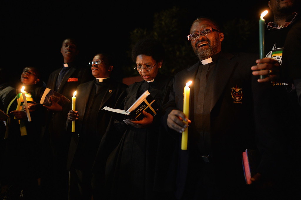 . JOHANNESBURG, SOUTH AFRICA - JUNE 27:  ANC supporters hold a candlelit vigil outside the former home of former South African President Nelson Mandela in Soweto township on June 27, 2013 in Johannesburg, South Africa. South African President Jacob Zuma confirmed on June 23 that Mandela\'s condition has become critical since he was admitted to the hospital over two weeks ago for a recurring lung infection.  (Photo by Jeff J Mitchell/Getty Images)