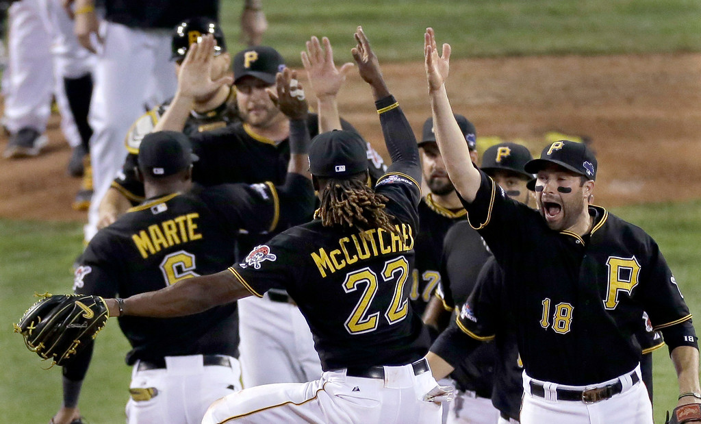 . Pittsburgh Pirates\' Andrew McCutchen (22) jumps and celebrates with teammate Neil Walker (18) after their 5-3 game 3 win over the St. Louis Cardinals in a National League baseball division series on Sunday, Oct. 6, 2013, in Pittsburgh. (AP Photo/Tom Puskar)