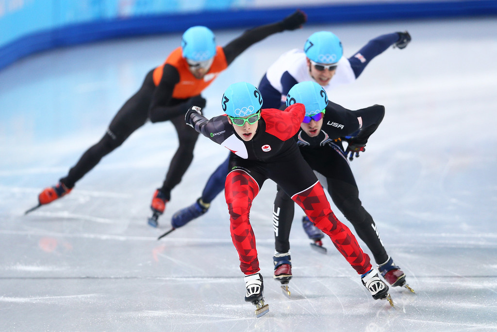 . SOCHI, RUSSIA - FEBRUARY 13:  (front to back) Charle Cournoyer of Canada, Chris Creveling of the United States, Jon Eley of Great Britain and Niels Kerstholt of the Netherlands compete in the Short Track Men\'s 1000m Heats on day 6 of the Sochi 2014 Winter Olympics at at Iceberg Skating Palace on February 13, 2014 in Sochi, Russia.  (Photo by Paul Gilham/Getty Images)