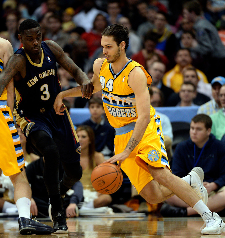 . Denver Nuggets guard Evan Fournier (94) drives on New Orleans Pelicans guard Anthony Morrow (3) April 2, 2014 at the Pepsi Center in Denver. (Photo by John Leyba/The Denver Post)