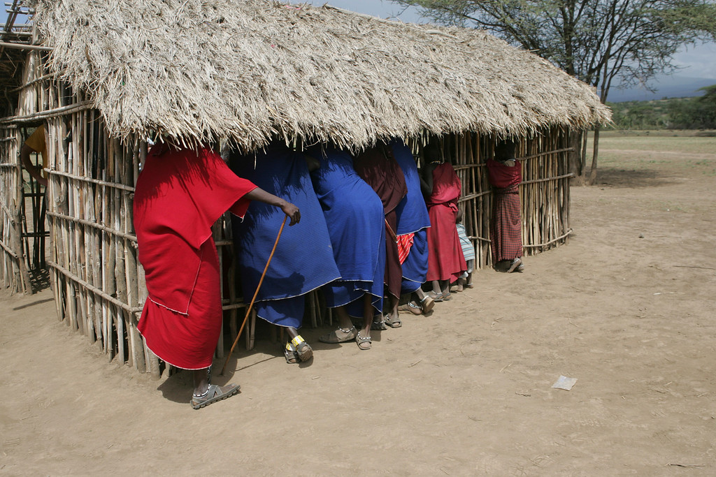 . Masai people visit a school house in their village Masai warriors in their village near Ngorongoro Crater in Tanzania, Africa.