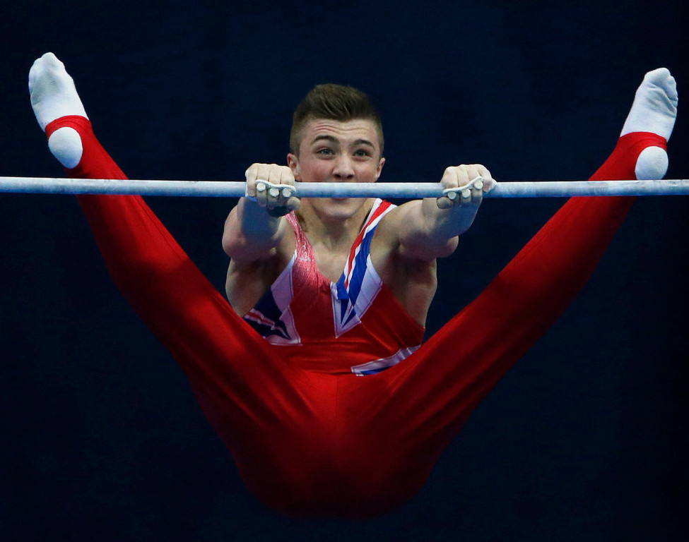 . Britain\'s Sam Oldham competes on the horizontal bar during the men\'s apparatus finals at the European Men\'s and Women\'s Artistic Gymnastic Individual Championships in Moscow April 21, 2013.  REUTERS/Grigory Dukor