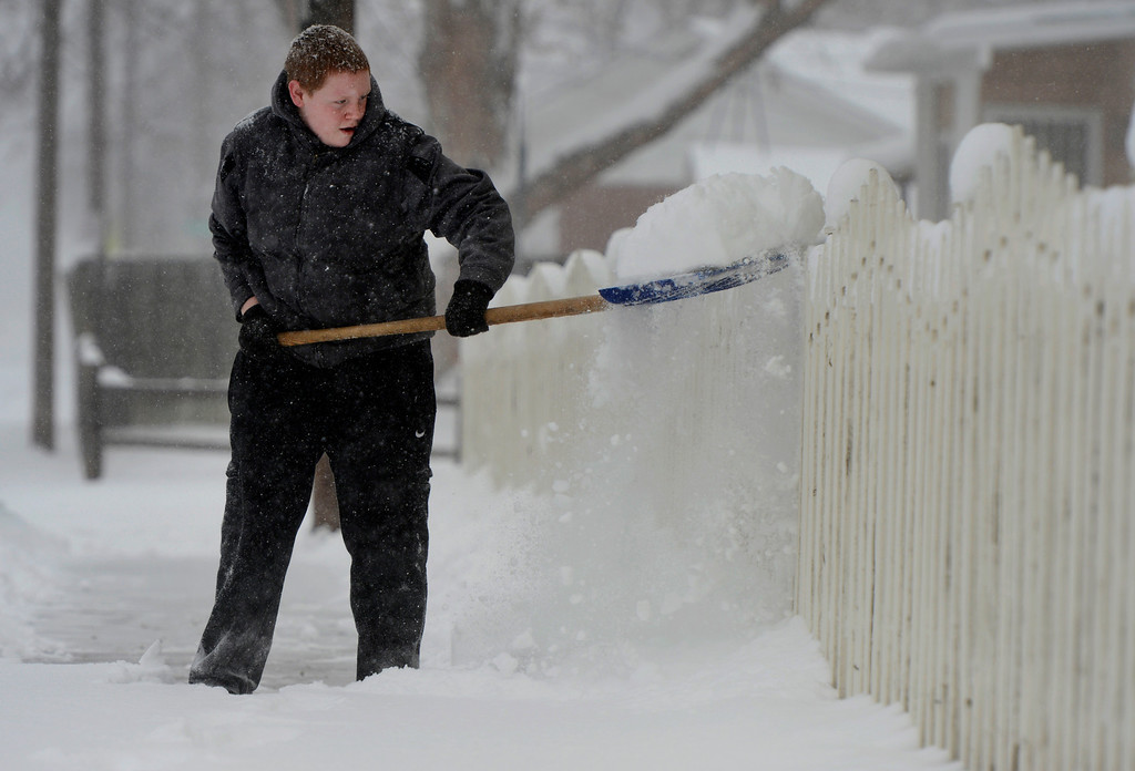 . ENGLEWOOD, CO. - MARCH 23: Zack Hughson, 15, shovels the sidewalk outside a neighbors home in Englewood, CO March 23, 2013. The Saturday forecast calls for snow accumulation of 9 to 12 inches with highs in the lower to mid 20s. (Photo By Craig F. Walker/The Denver Post)