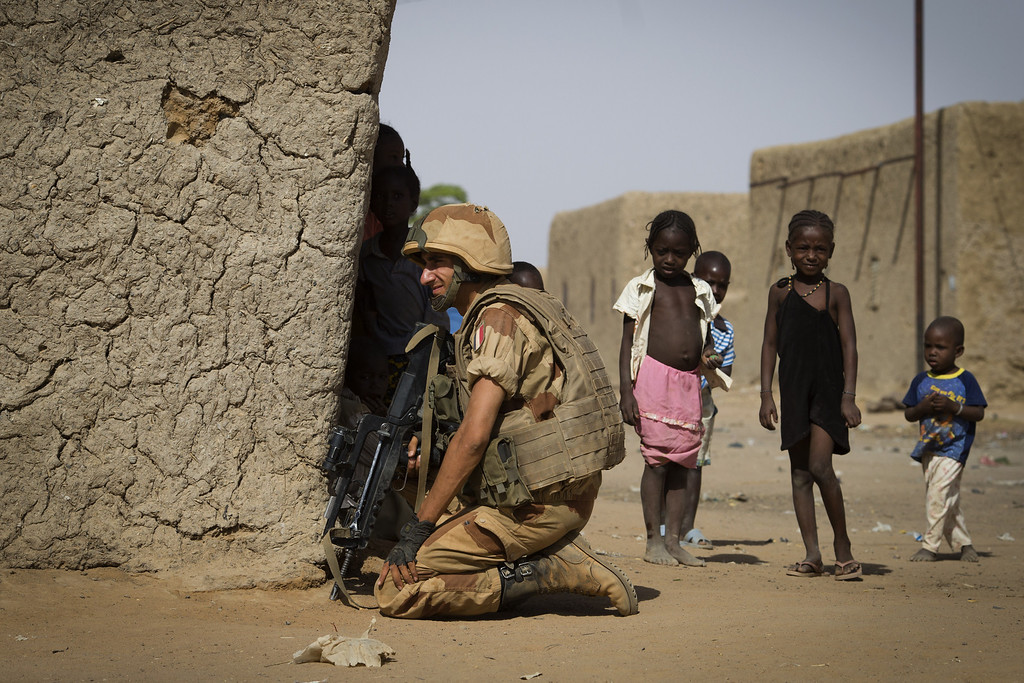 . A French soldier keeps a lookout next to children in a street of Gao, on April 5, 2013. The United Nations expressed concern over reprisal attacks against ethnic Tuaregs and Arabs in Mali, where a French-led intervention recently routed Islamist rebels.  JOEL SAGET/AFP/Getty Images