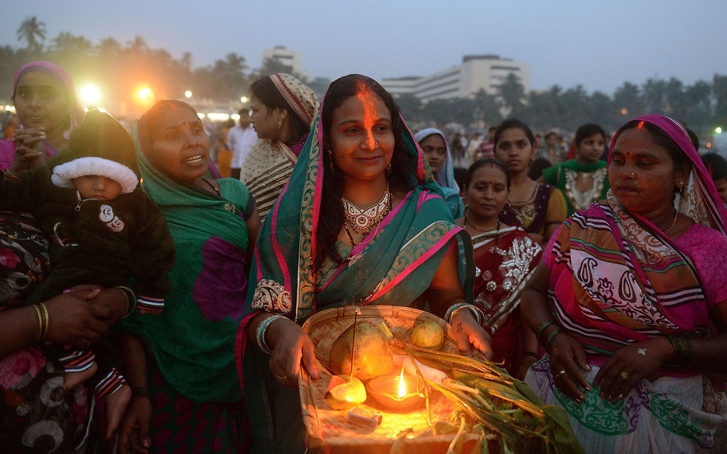 . Indian women offer prayers at the seafront during the \'Chhath Puja\' festival in Mumbai on November 8, 2013.   AFP PHOTO/ PUNIT PARANJPE/AFP/Getty Images