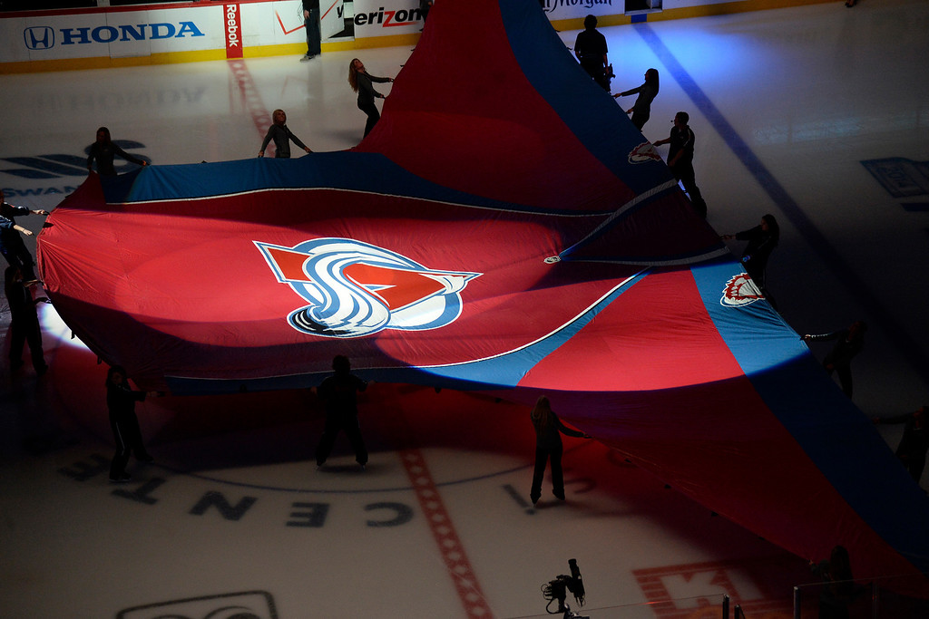 . Avs girls hold a giant jersey at center ice during the first period of action. The Colorado Avalanche hosted the Minnesota Wild in the first round of the Stanley Cup Playoffs at the Pepsi Center on Saturday, April 19, 2014. (Photo by AAron Ontiveroz/The Denver Post)