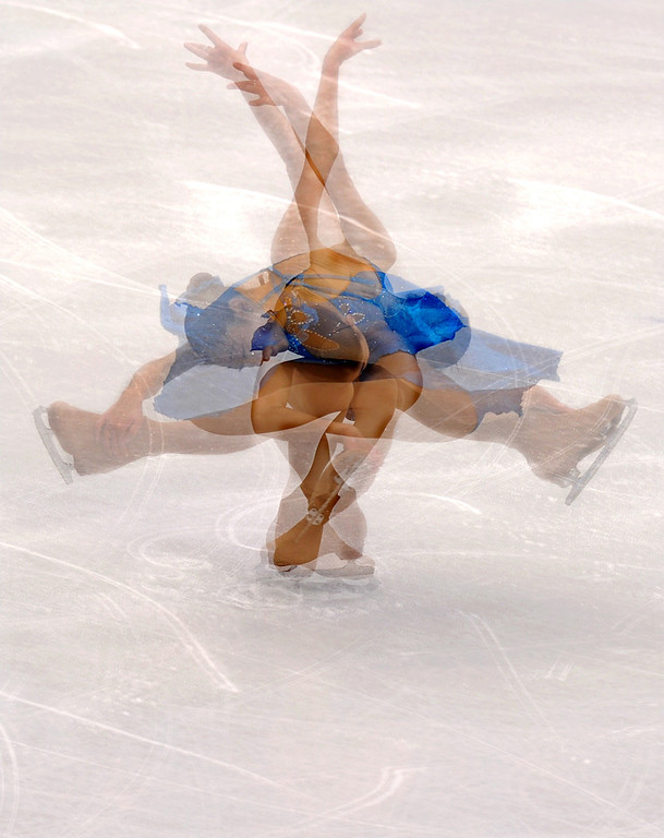 . This multiple exposure picture shows US Mirai Nagasu performing during her figure skating training session during the 2010 Winter Olympics at Pacific Coliseum in Vancouver on February 21, 2010. (YURI KADOBNOV/AFP/Getty Images)