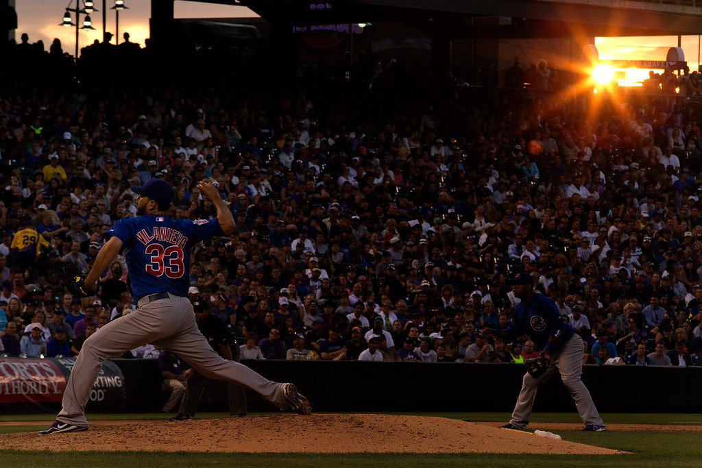 . DENVER, CO - JULY 20:  Starting pitcher Carlos Villanueva #33 of the Chicago Cubs delivers to home plate during the fifth inning against the Colorado Rockies at Coors Field on July 20, 2013 in Denver, Colorado.  (Photo by Justin Edmonds/Getty Images)