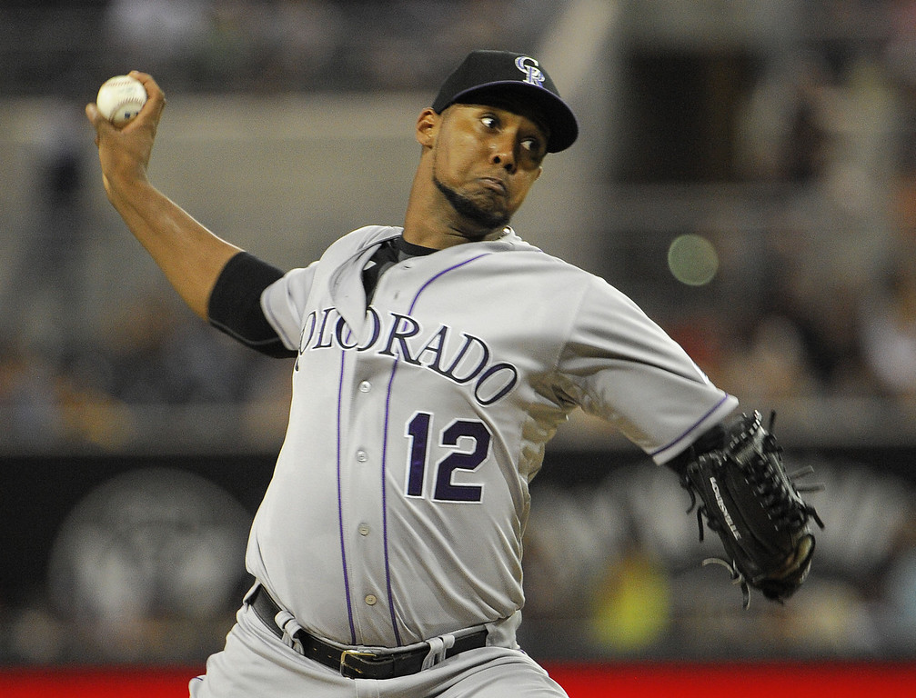 . SAN DIEGO, CA - SEPTEMBER 6:  Juan Nicasio #12 of the Colorado Rockies pitches during the first inning of a baseball game against the San Diego Padres at Petco Park on September 6, 2013 in San Diego, California.  (Photo by Denis Poroy/Getty Images)