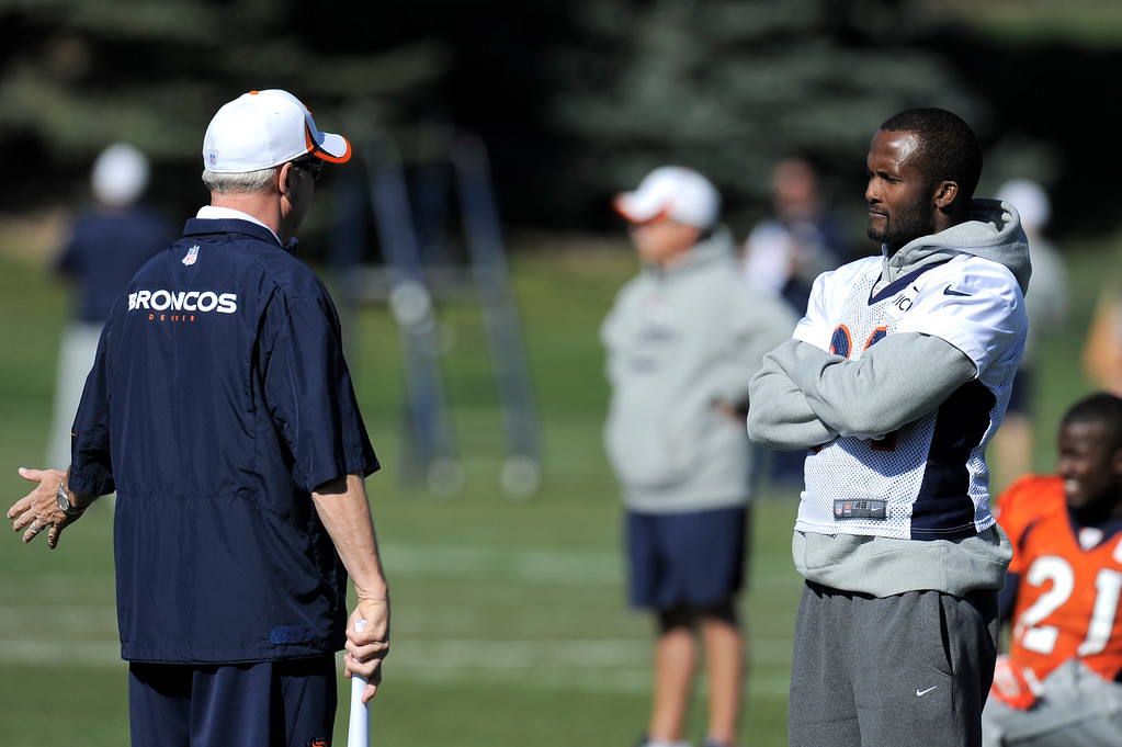 . Denver Broncos head coach John Fox talks with Denver Broncos cornerback Champ Bailey (24) before practice on October 24, 2013 at Dove Valley. (Photo by John Leyba/The Denver Post)