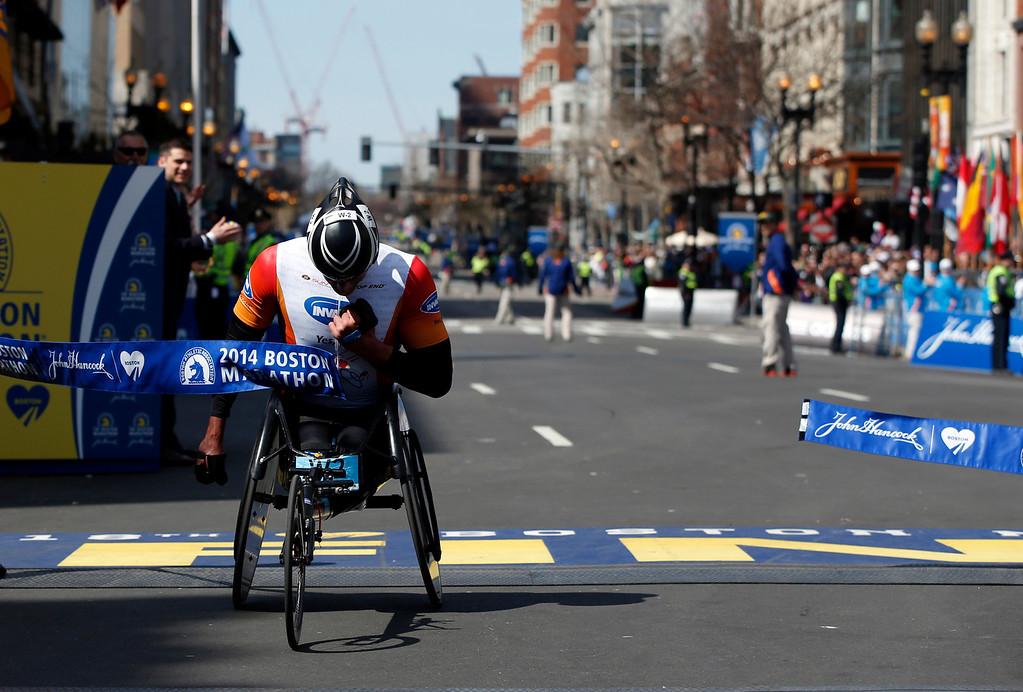 . Ernst Van Dyk, of South Africa, breaks the tape to win the men\'s wheelchair division of the 118th Boston Marathon Monday, April 21, 2014 in Boston. (AP Photo/Elise Amendola)