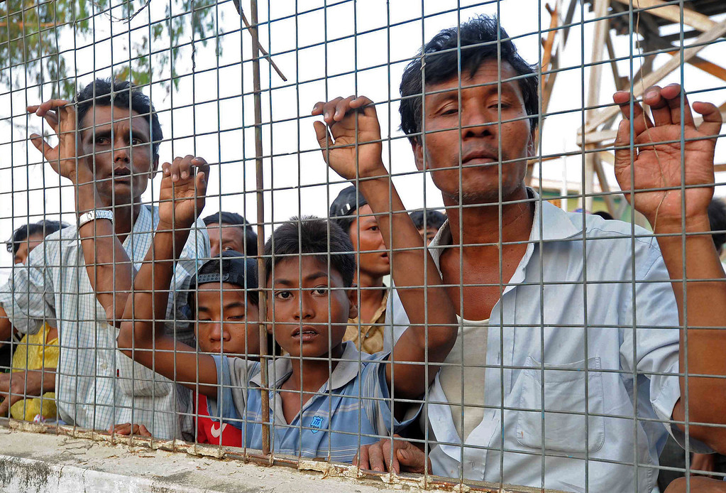 . Muslim residents look out from a temporary relief camp after their evacuation from riot-hit Meiktila, central Myanmar on March 22, 2013.    AFP PHOTO/ Soe Than WIN/AFP/Getty Images