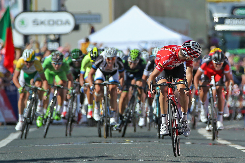 . Tony Gallopin of France and Lotto Belisol looks back as the peloton closes in on his solo breakaway in the final meters as he held on to win the eleventh stage of the 2014 Tour de France, a 188km stage between Besancon and Oyonnax, on July 16, 2014 in Oyonnax, France.  (Photo by Doug Pensinger/Getty Images)