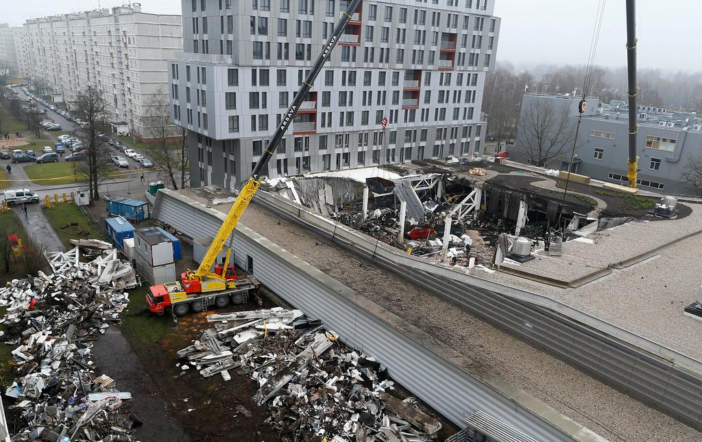 . A view of collapsed Maxima supermarket in Riga, Latvia, Saturday, Nov. 23, 2013.  (AP Photo/Mindaugas Kulbis)
