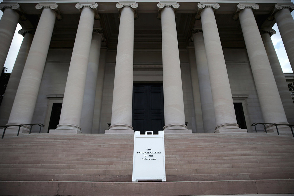 . A sign alerting visitors that the National Gallery of Art is closed stands outside the building as it remains indefinitely closed on the National Mall October 1, 2013 in Washington, DC. Smithsonian institutions were closed and thousands of employees were furloughed after Congress was unable to agree on a federal budget and shut down the goverment for the first time in 17 years.  (Photo by Chip Somodevilla/Getty Images)